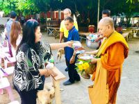 Offering food to monks on the Thai New Year